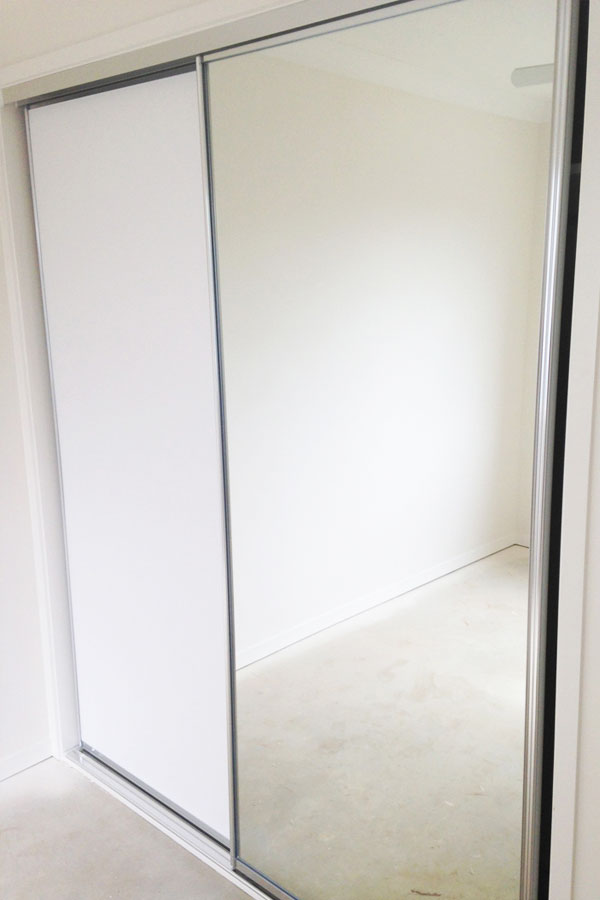 glass wardrobe doors design and install by DnD glass glazing located in tweed heads